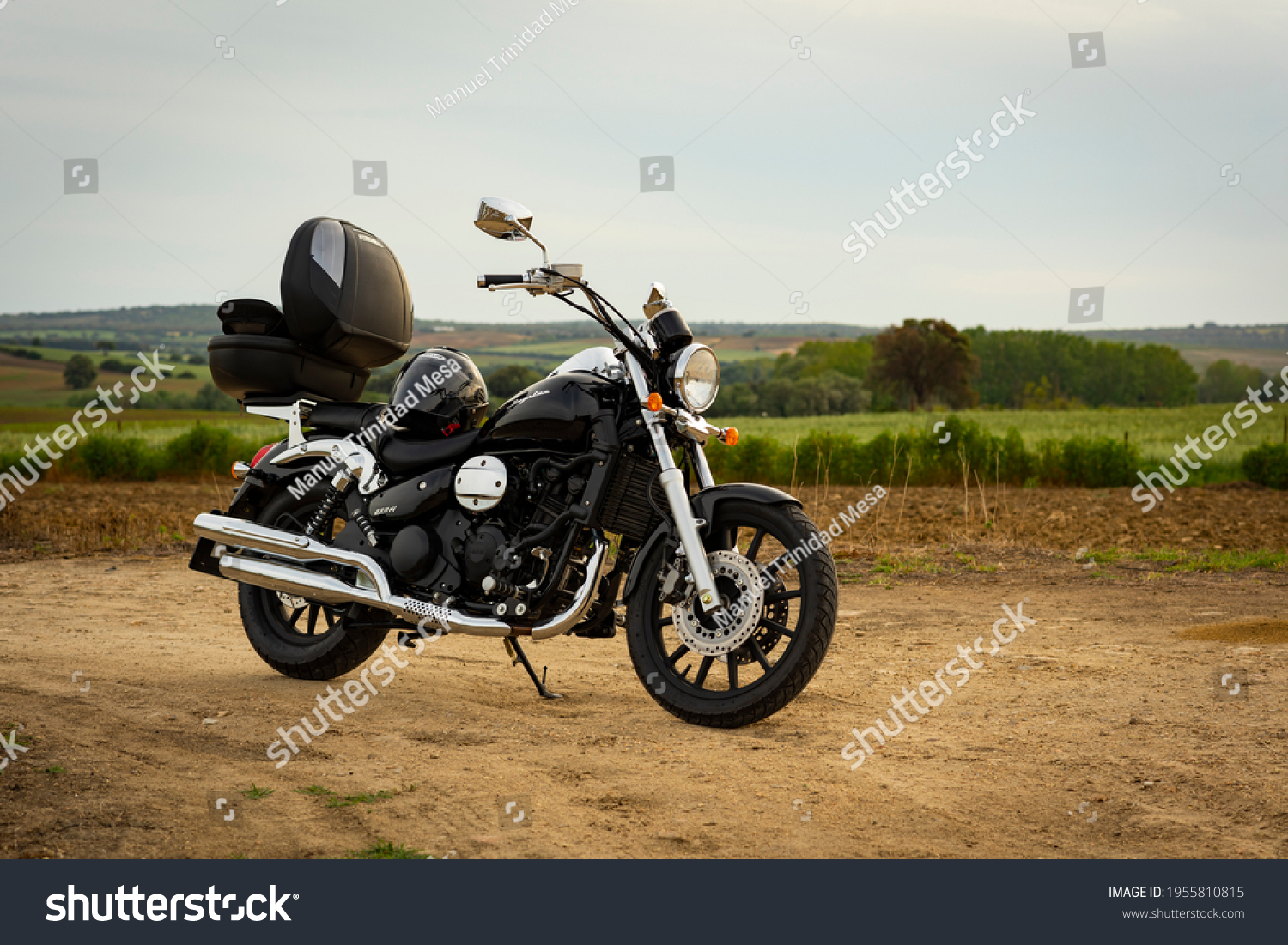 Cadiz, Andalusia, Spain, April 13, 2021 Daelim Daystar 250 fi motorcycle, in the field, with open suitcase and helmet on the seat