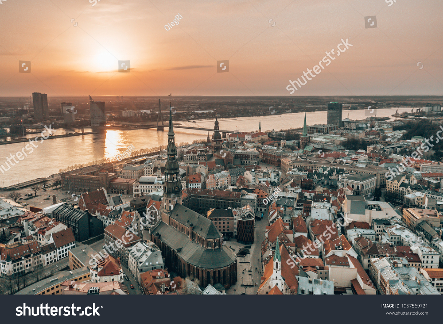 RIga rooftop view panorama at sunset with urban architectures and Daugava River. View of the old town #1957569721