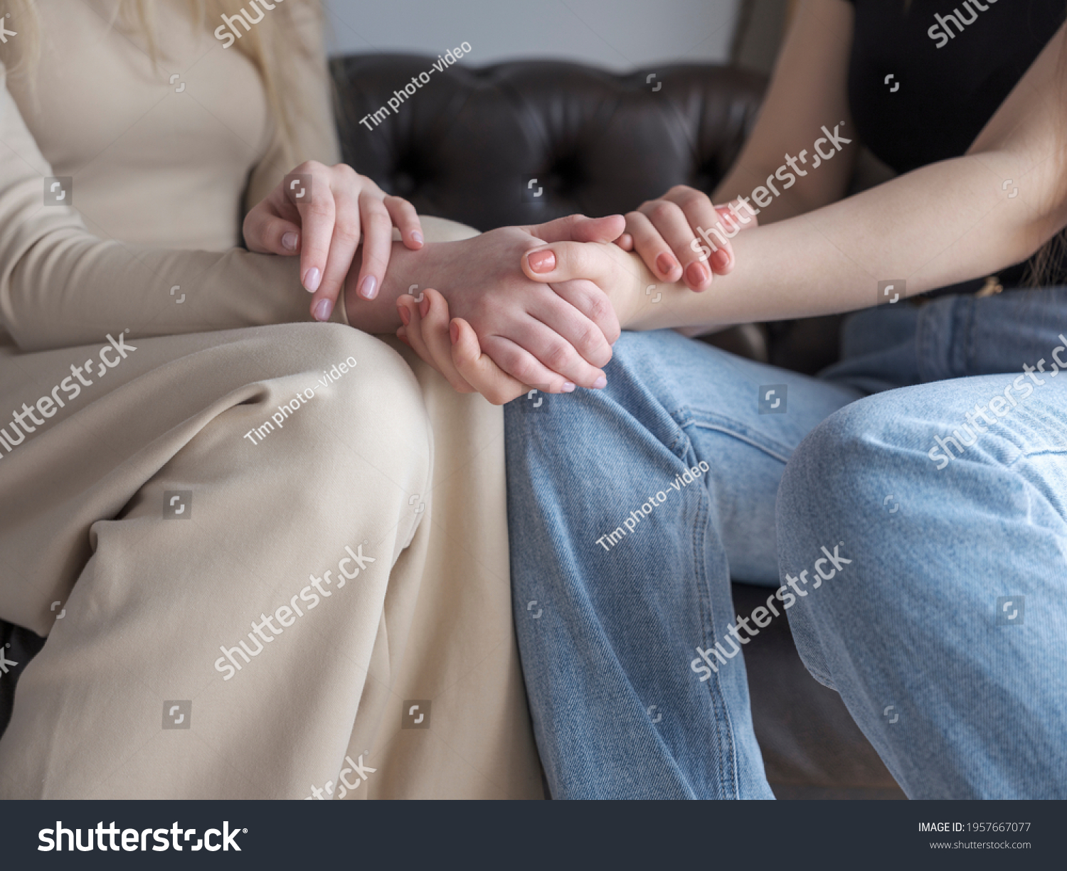 stock-photo-two-women-are-sitting-on-the