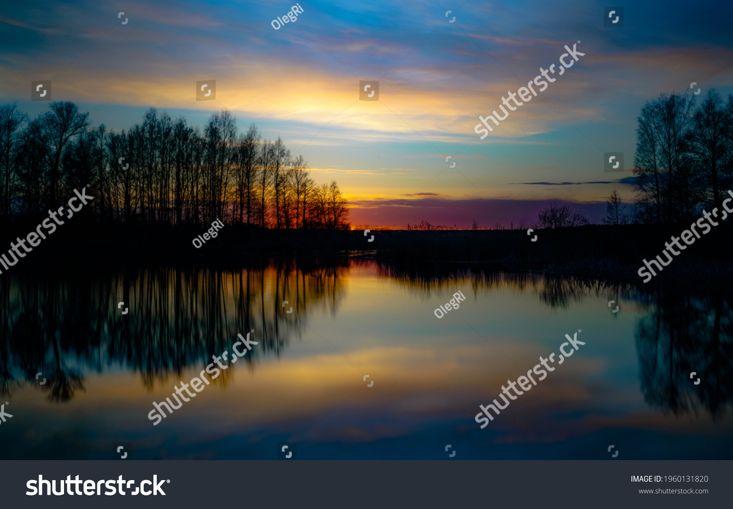 sunset at coast of the lake. Nature landscape. Nature in northern Europe. reflection, blue sky and yellow sunlight. landscape during sunset. #1960131820