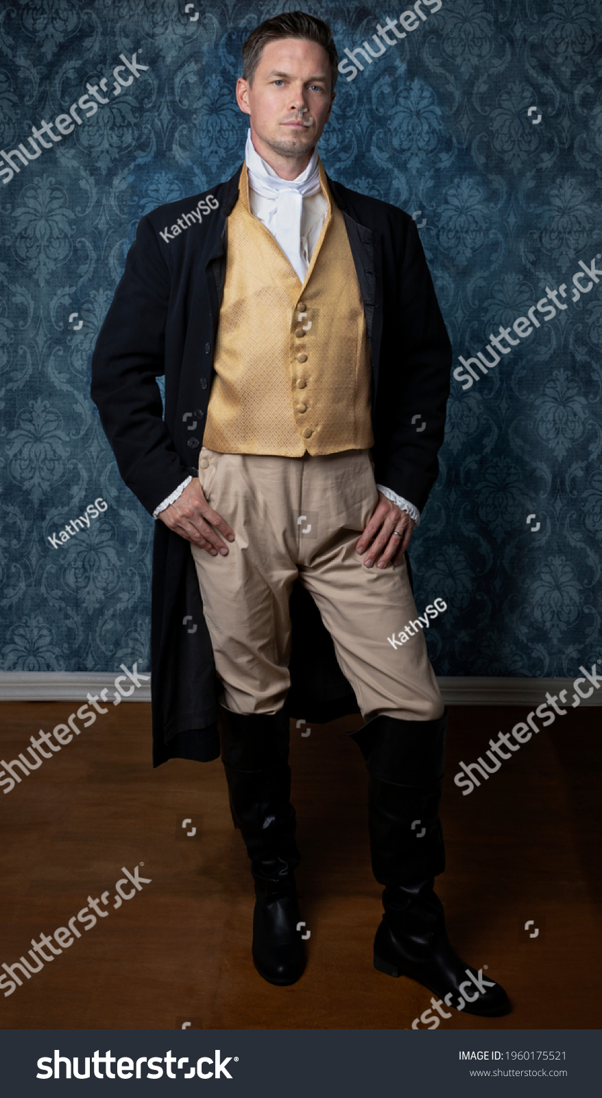 A handsome Regency gentleman wearing a gold waistcoat and black jacket and standing in a room with blue wallpaper and a wooden floor #1960175521