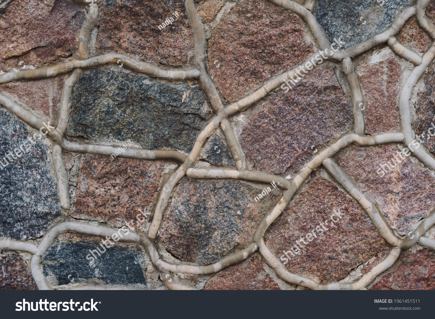 stone pavement with abstract pattern.  #1961451511
