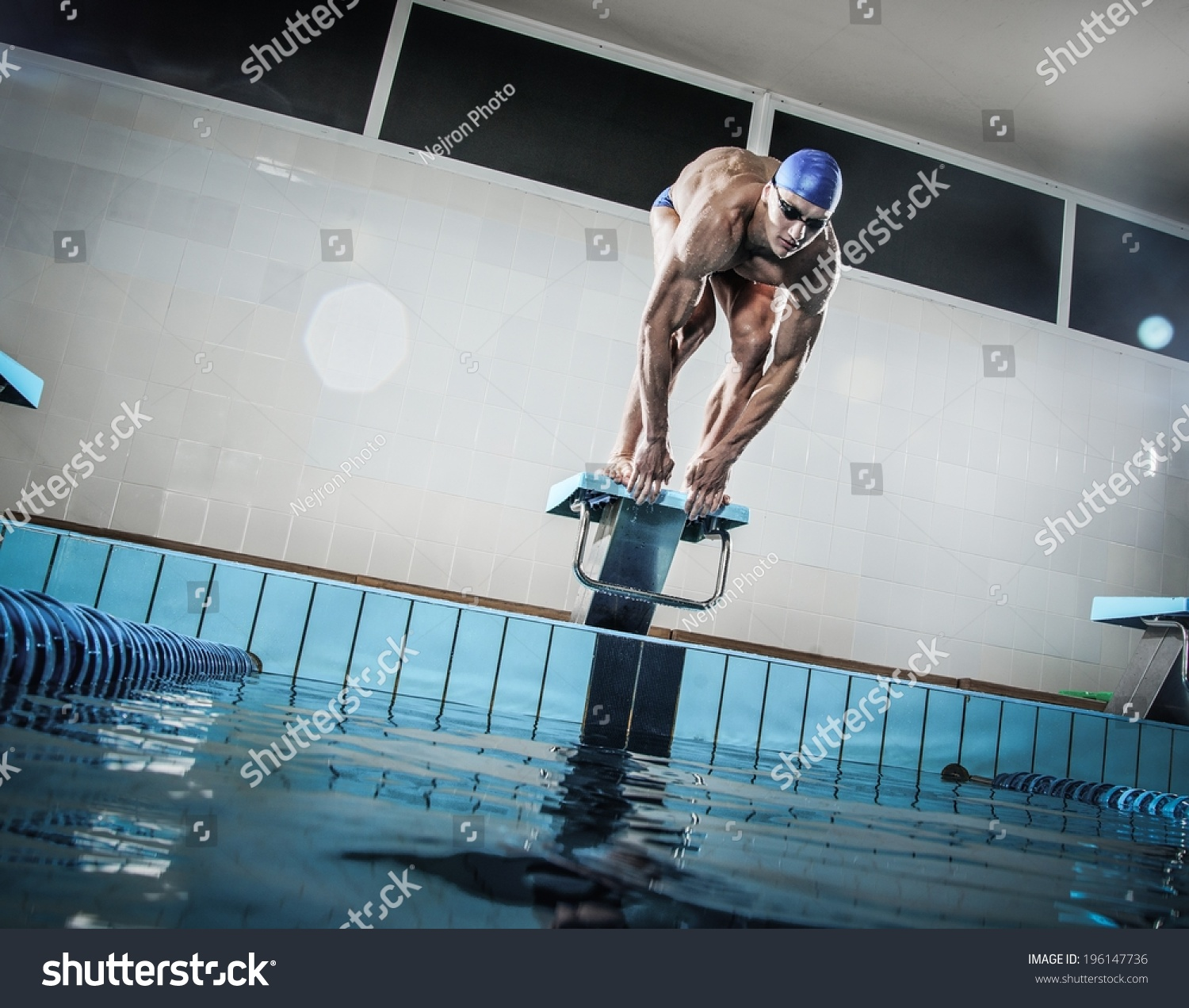Olympic Swimming Pool In Person: Young Muscular Swimmer Low Position On Stock Photo