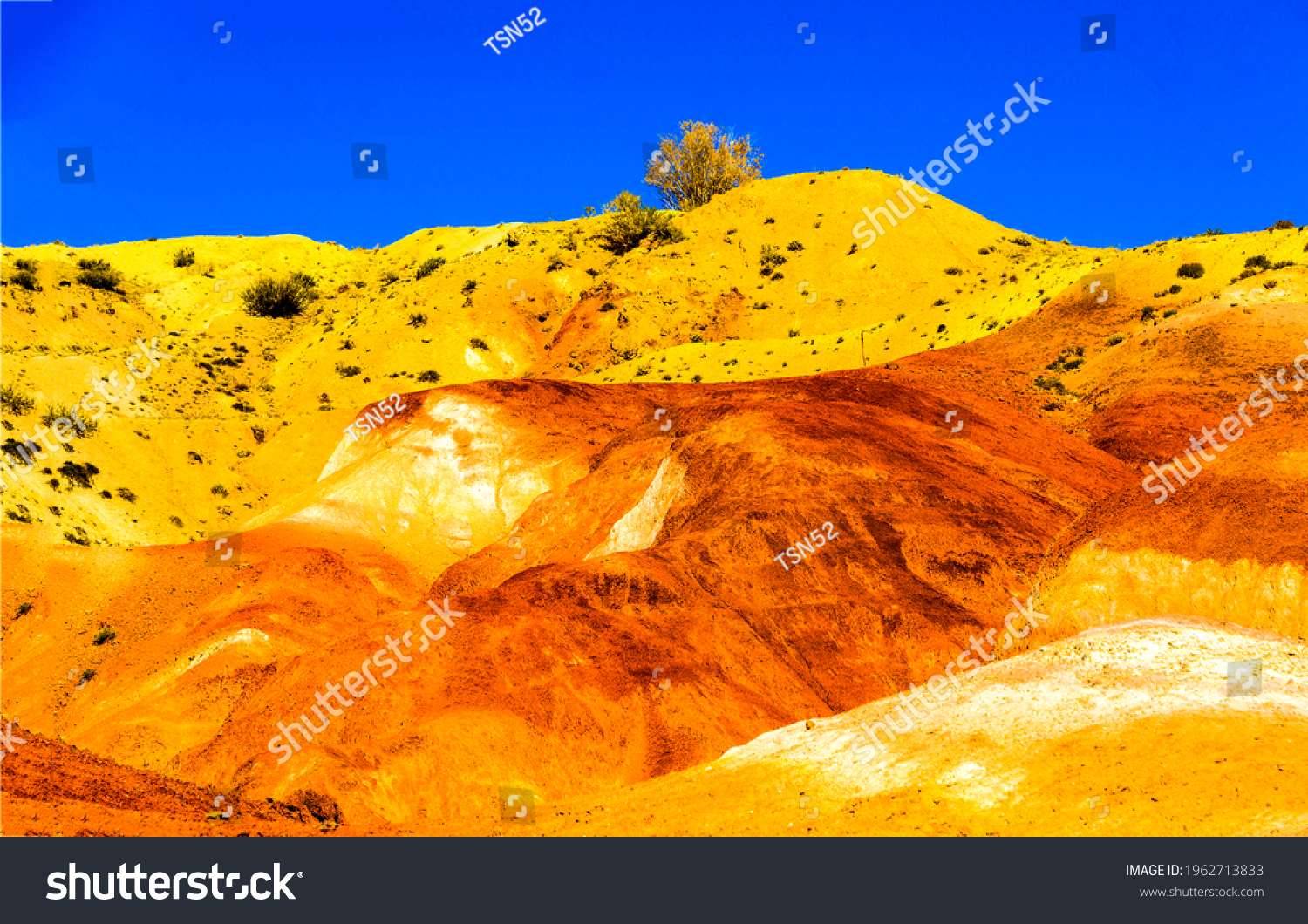 Sand hill in the middle of the desert. Orange yellow sand hill on clear blue sky background. Sand hill on blue sky background. Sand hill view #1962713833