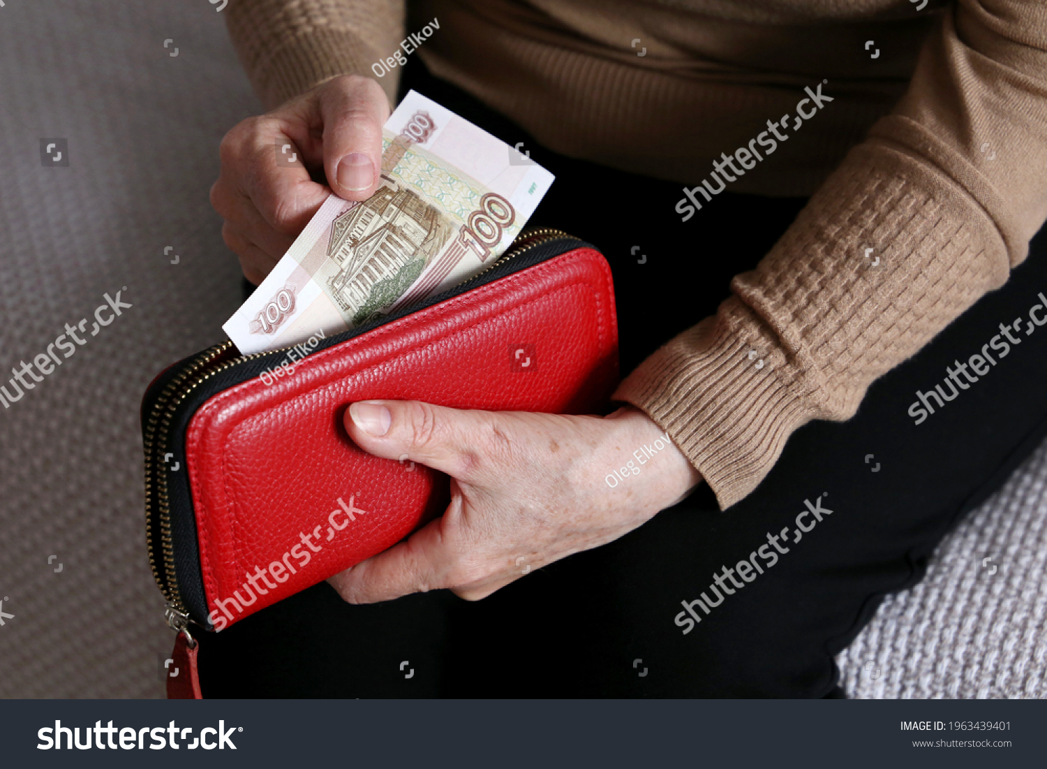 Elderly woman takes out russian rubles from her wallet, wrinkled female hands closeup. Concept of poverty in Russia, pension payments, pensioner #1963439401