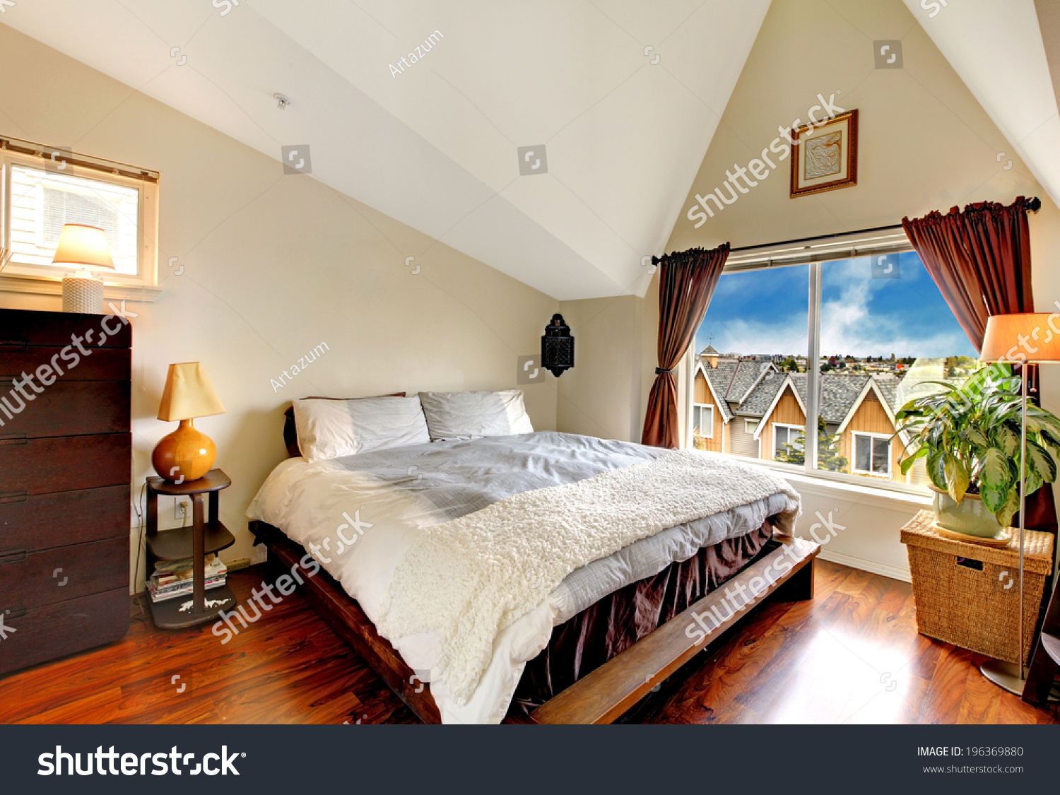 Nice Bedroom With Vaulted Ceiling Hardwood Floor And Window Furnished With