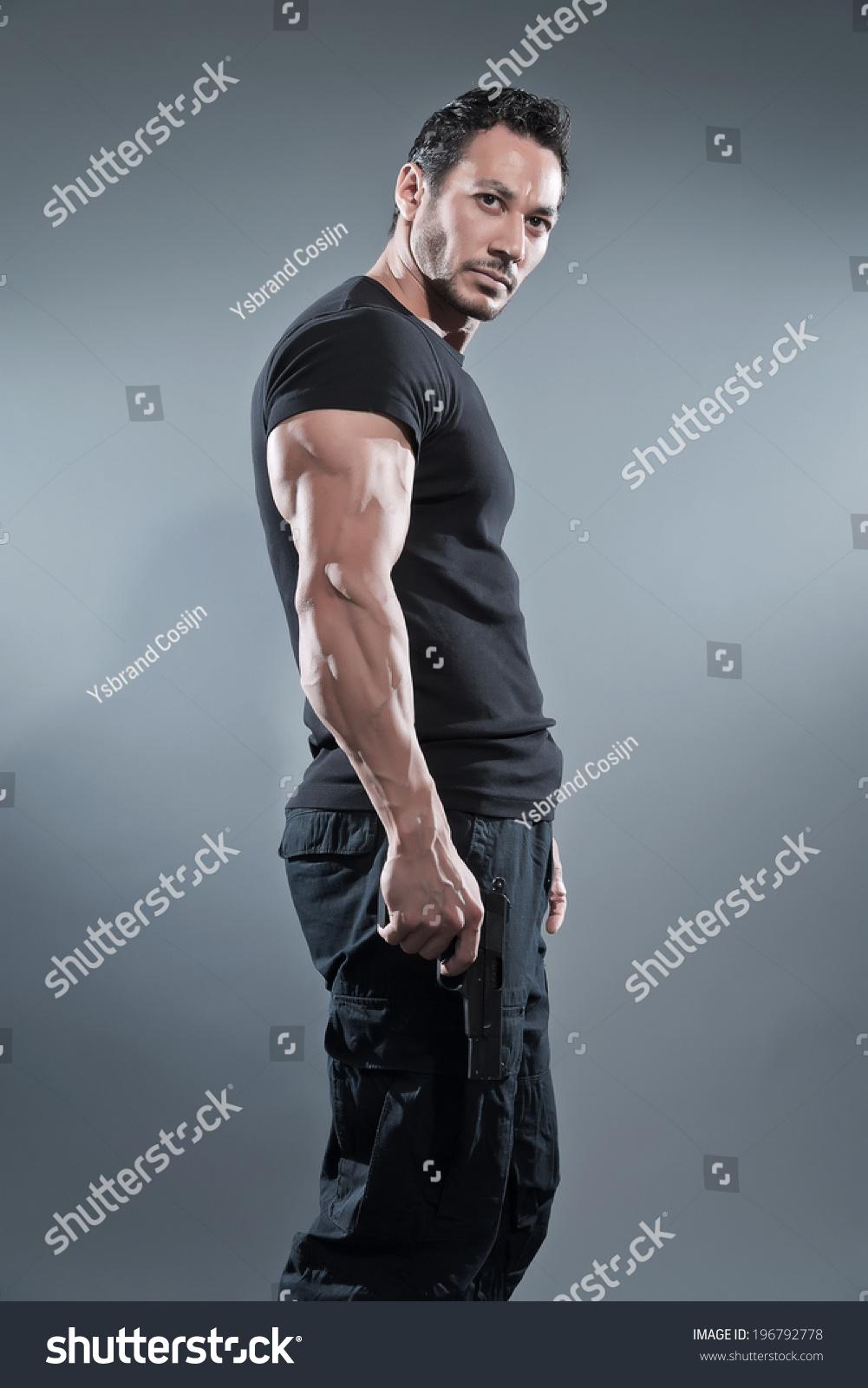 Black t shirt navy pants - Black T Shirt Grey Pants Action Hero Muscled Man Holding A Gun Wearing Black T