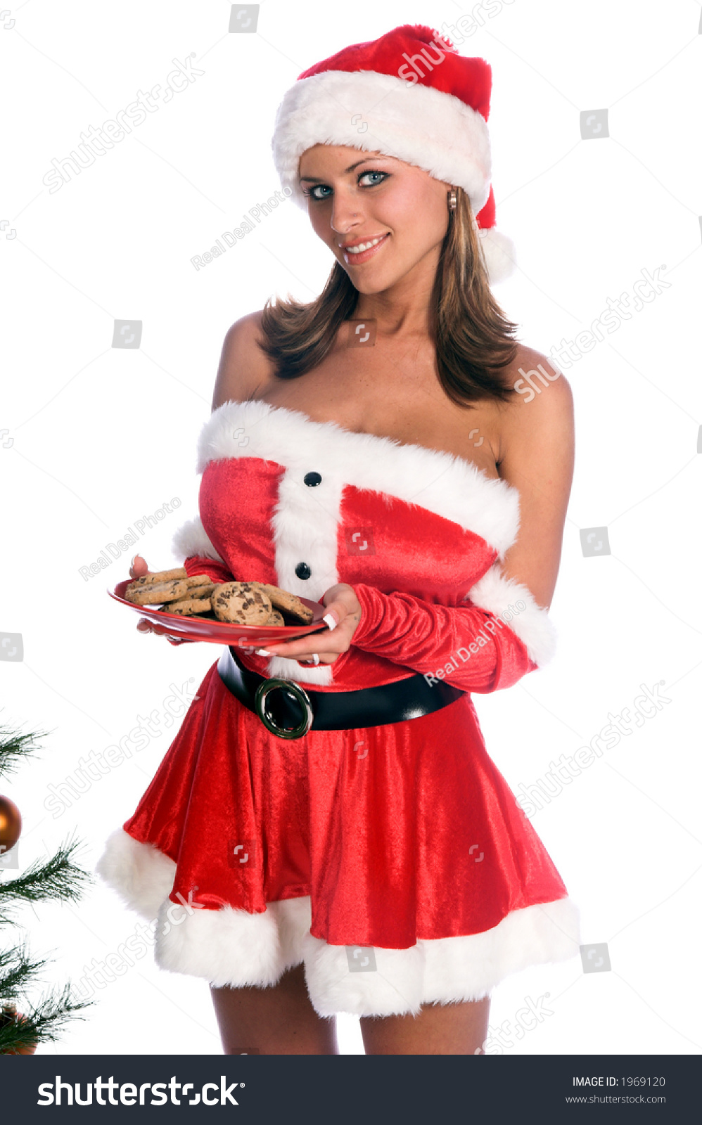 Sexy ms santa claus sitting by stock photo