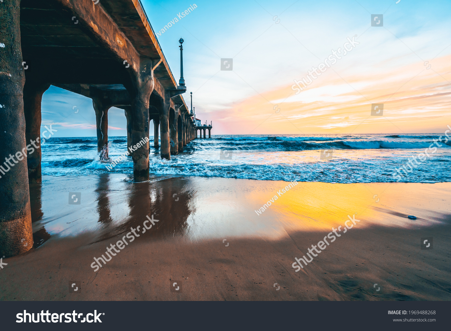 Manhattan beach pier at sunset, orange-pink sky with bright colors, beautiful landscape with ocean and sand #1969488268