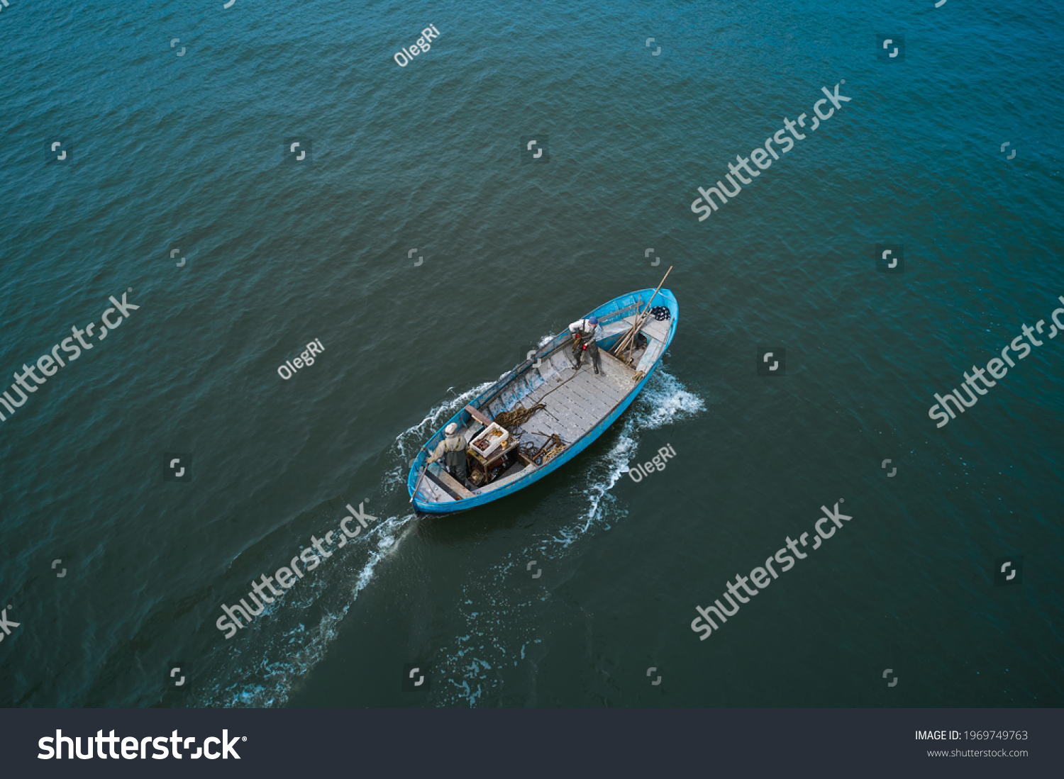 Fishing boats floating on the sea. Fishermans in boat. fishing boat sailing in open waters. man fishing on boat. sailing boat landscape #1969749763