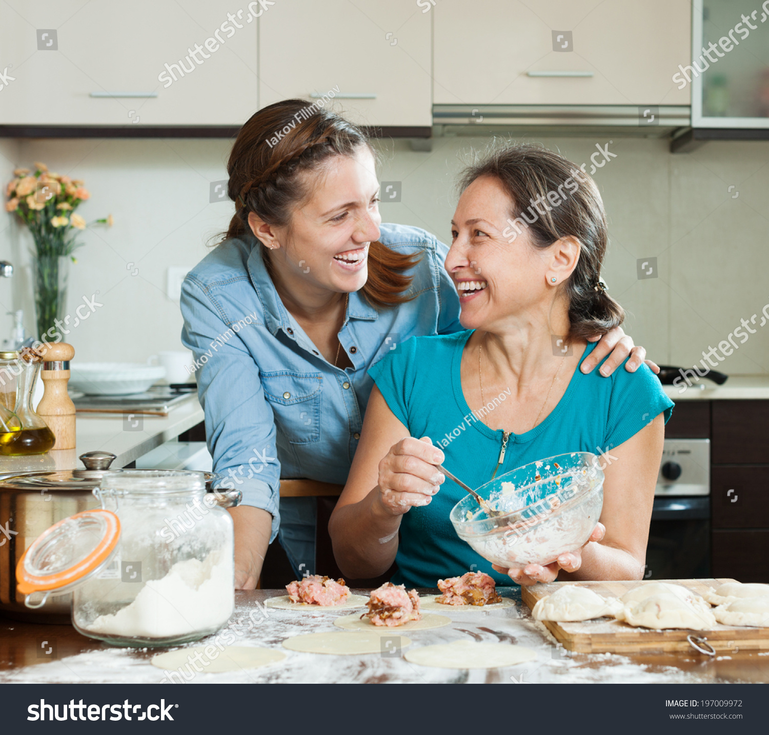 Two Laughing Women Making Pies Together Stock Photo (Edit Now ...