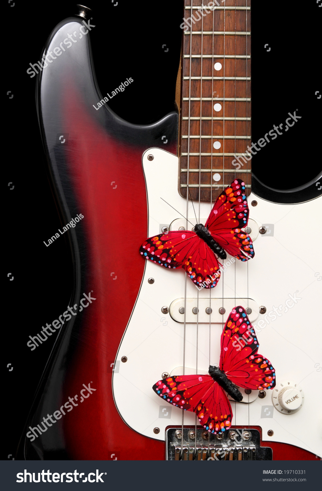 closeup on electric guitar and fake red butterflies black background stock photo 19710331. Black Bedroom Furniture Sets. Home Design Ideas