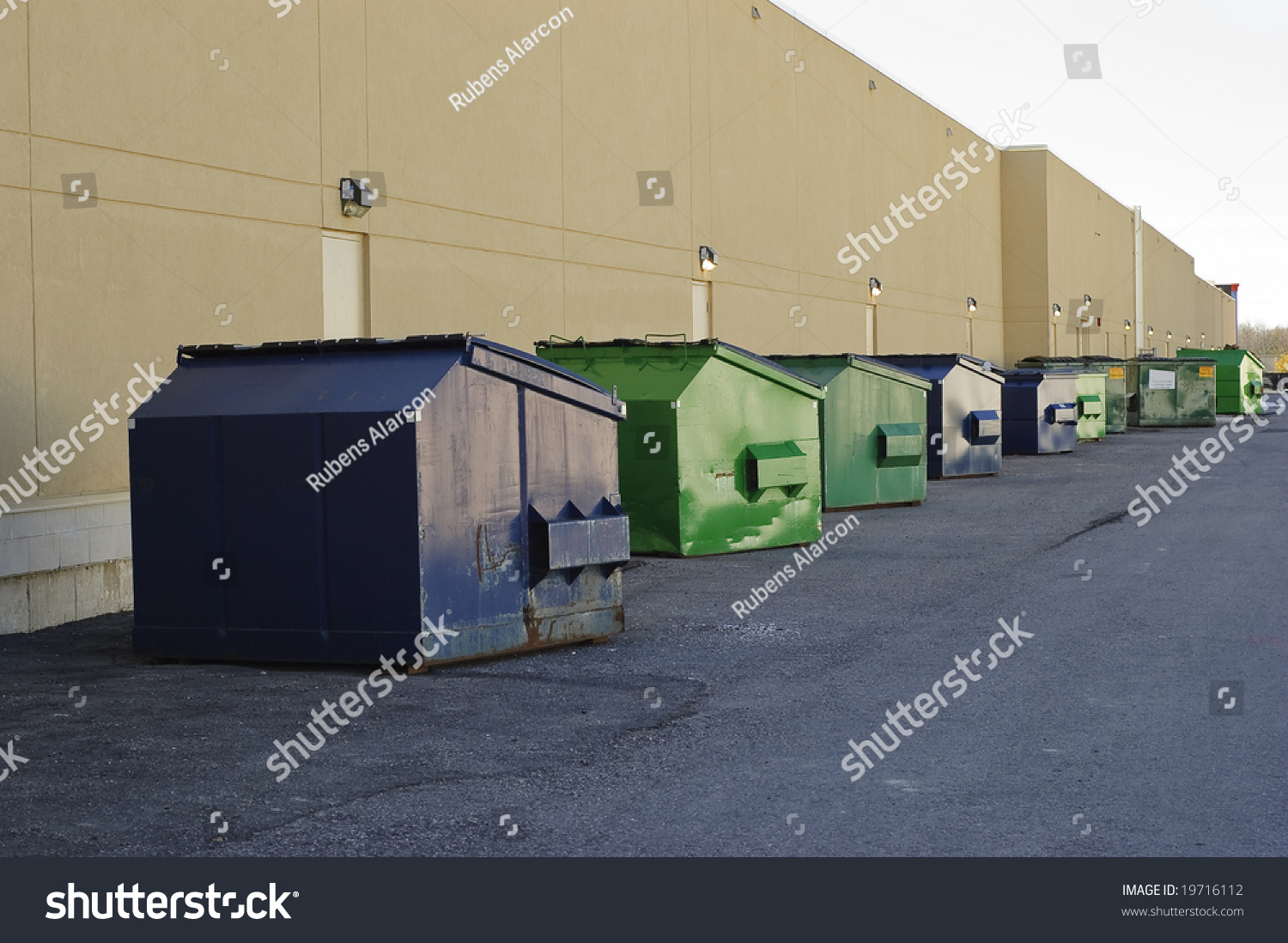Blue Green Industrial Garbage Bins Lined Stock Photo