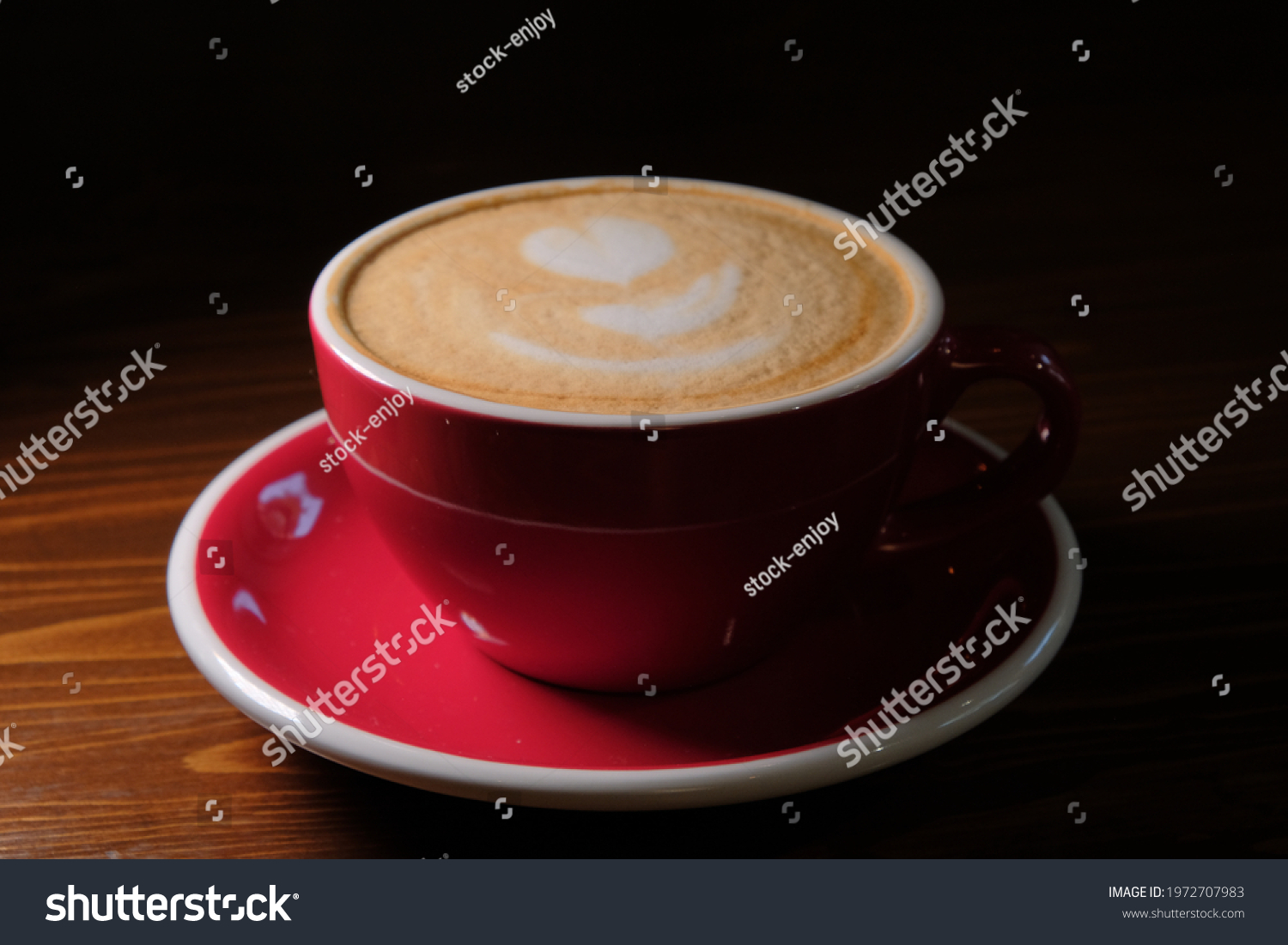 stock-photo-red-cup-of-coffee-in-dark-ro