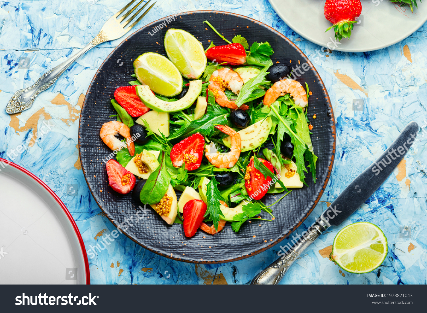 Fresh summer salad with prawn,strawberry,avocado,lime and olive.Summer salad,healthy eating #1973821043
