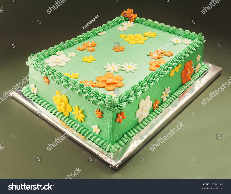 Decoration birthday cake symbolizes green field stock photo decoration of a birthday cake symbolizes green field with yellow orange and white flowers izmirmasajfo Gallery
