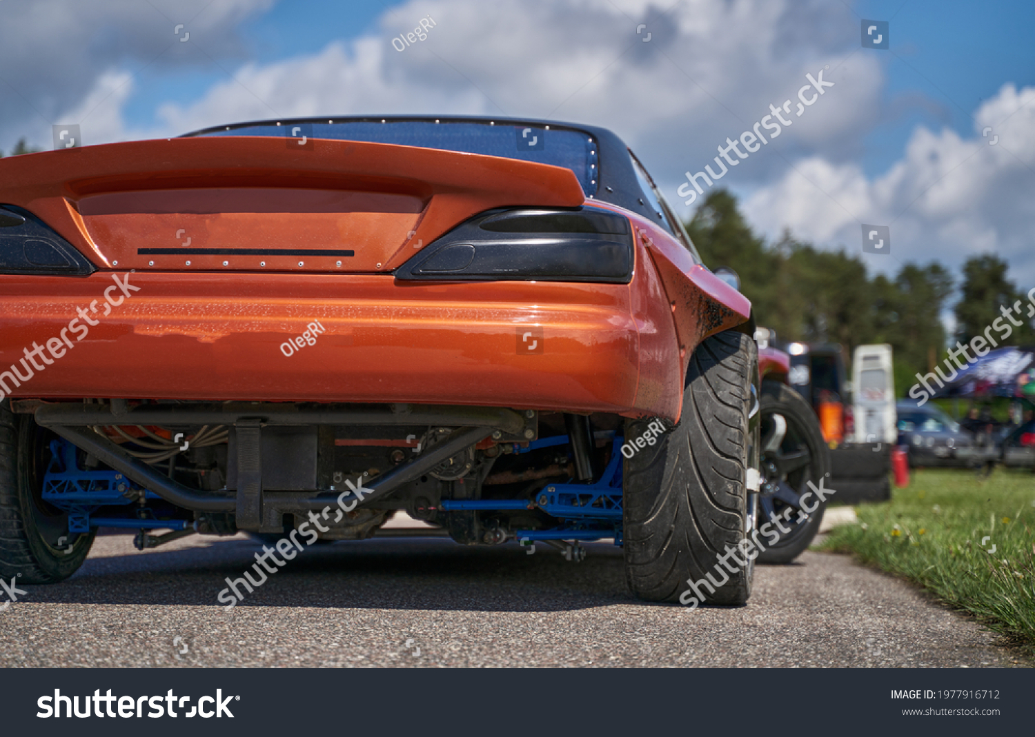 Power drifting car from side. back view #1977916712