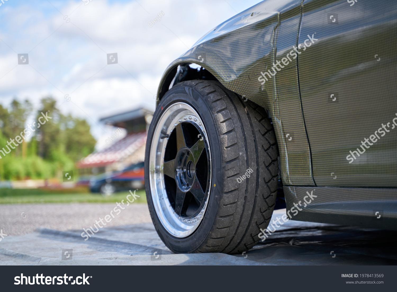 Rear side view front wheel of black car #1978413569