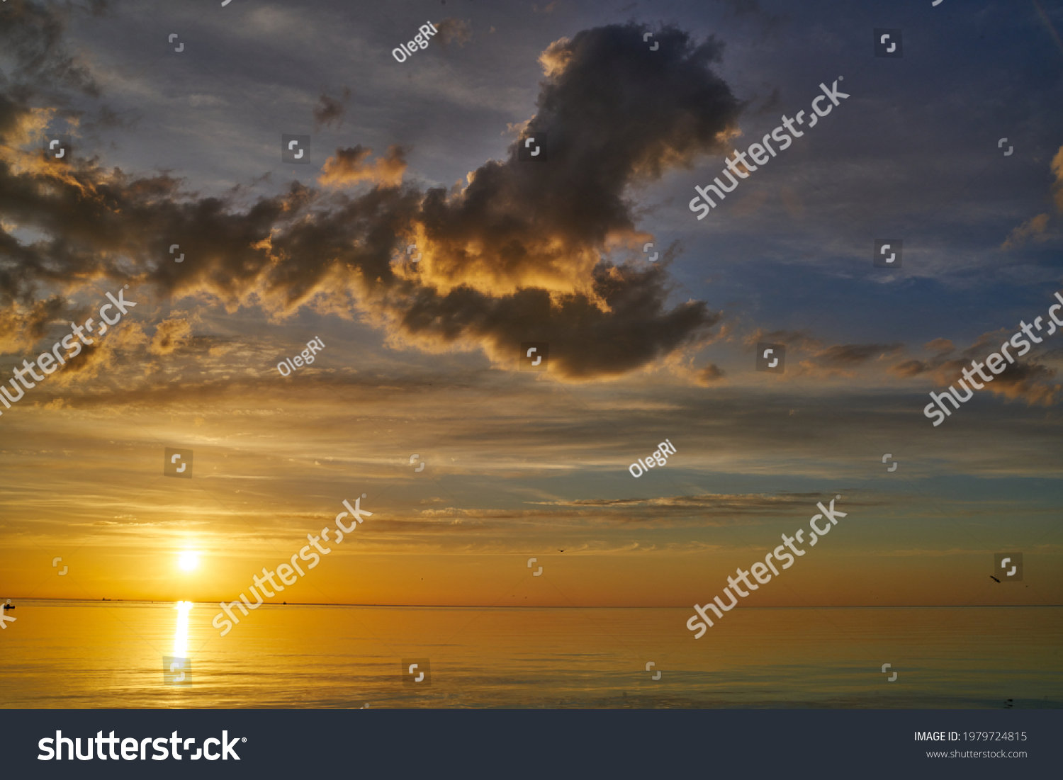 Evening sky with dramatic clouds over the sea. Dramatic sunset over the sea. #1979724815