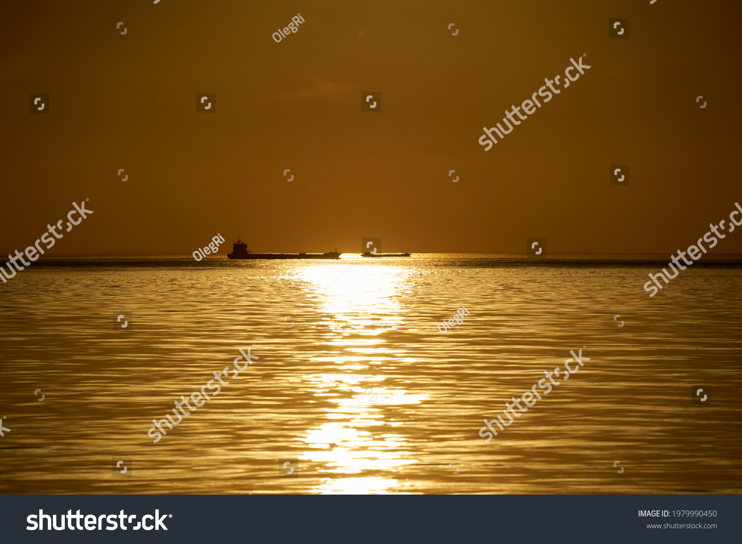 sunset at sea. variety of colors and hues of the rising sun. Sea landscape. #1979990450