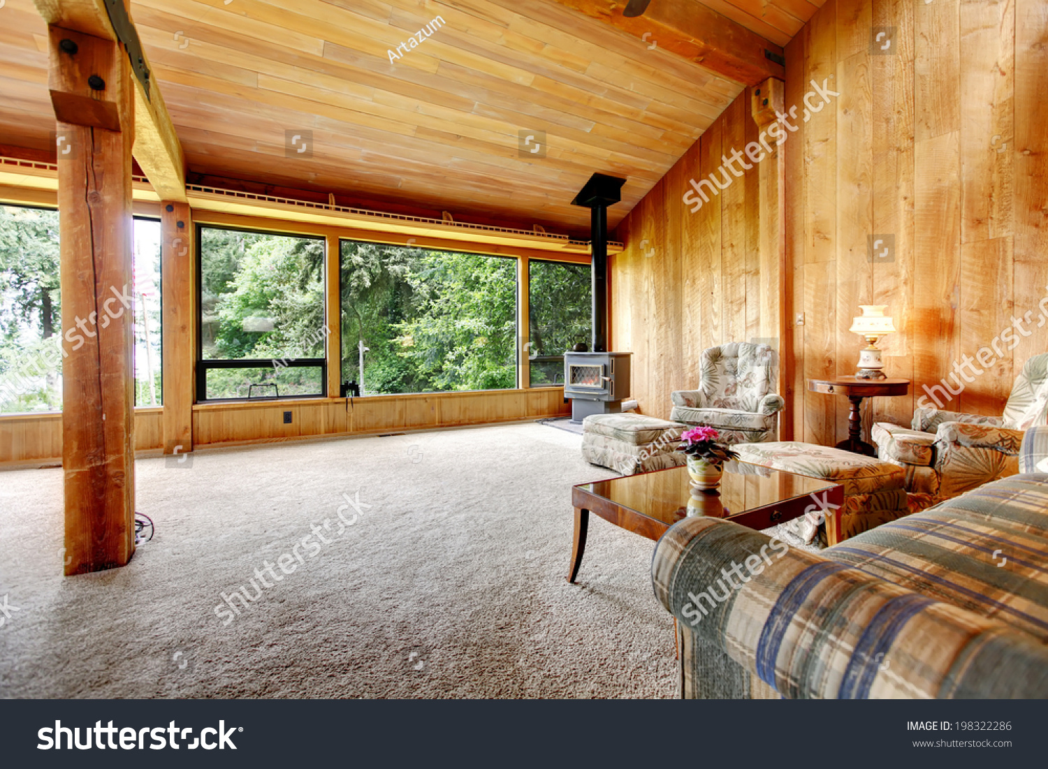 Cabin living room furniture sets - Spacious Log Cabin Living Room With High Vaulted Ceiling And Carpet Floor View Of Antique