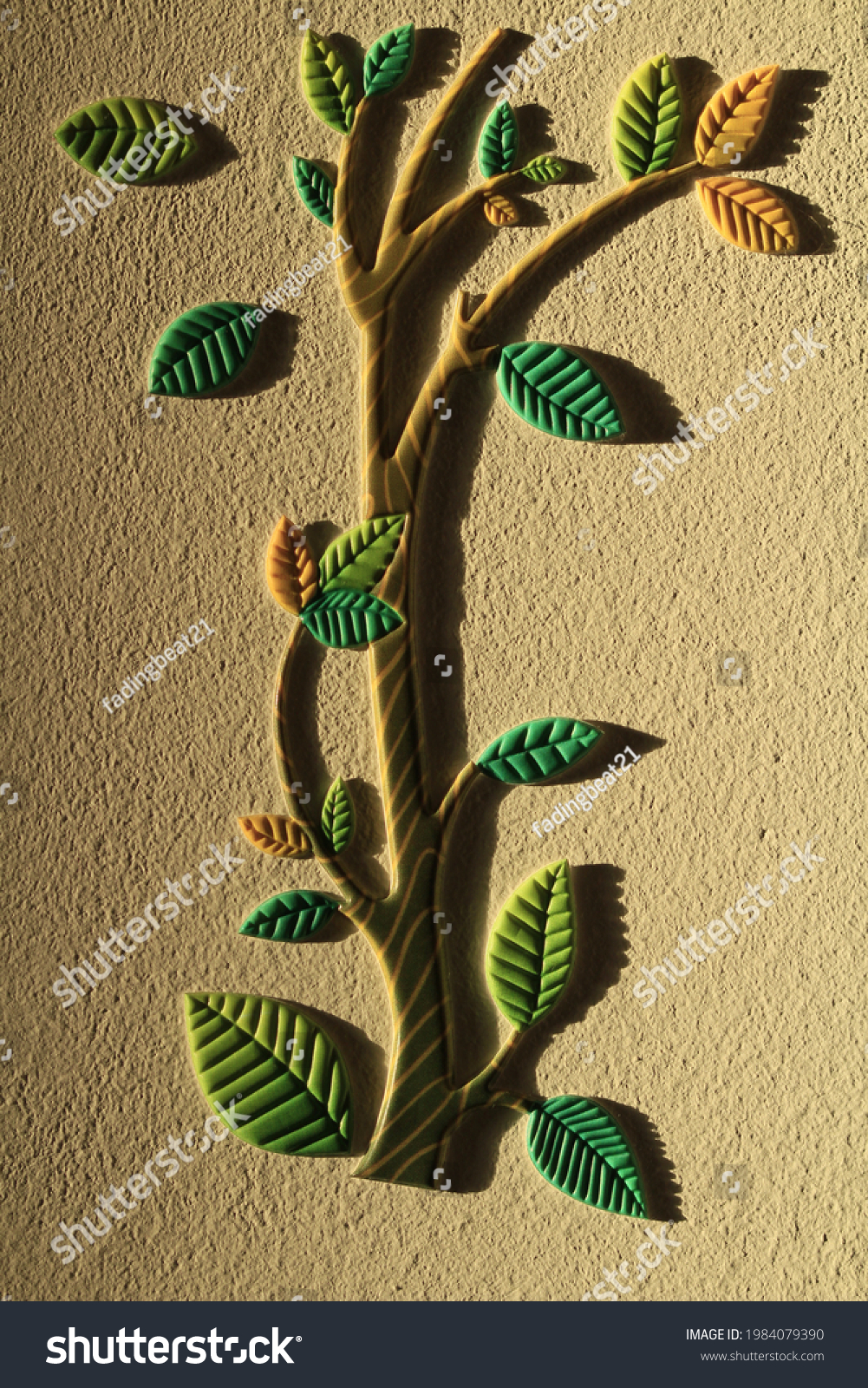 Tree with branches and leaves sticker glued to the wall.