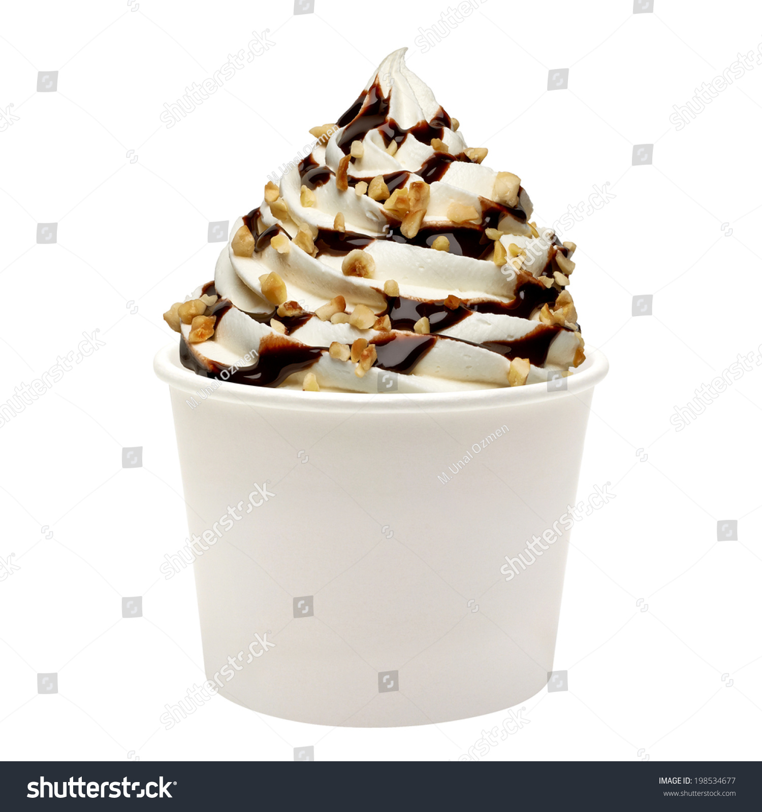 Soft ice cream with chocolate sauce and hazelnuts in paper cup on ...