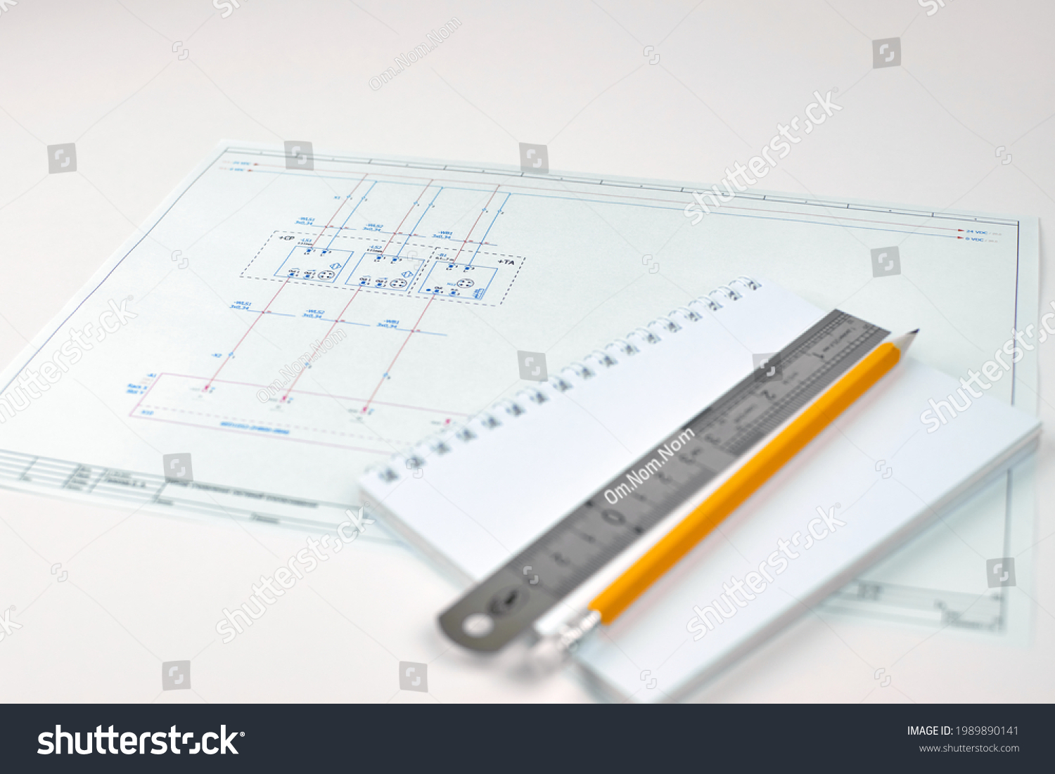 Printed circuit diagram. Engineer's drawing, close-up. Wiring diagram of electrical sensors. Design concept, electronics and engineering. Wiring diagram, close-up. Engineer's workplace. #1989890141