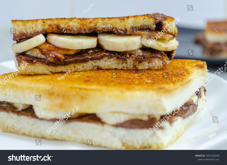 Yummy Chocolate Banana Sandwich cut into half on top of another. Macro shot.