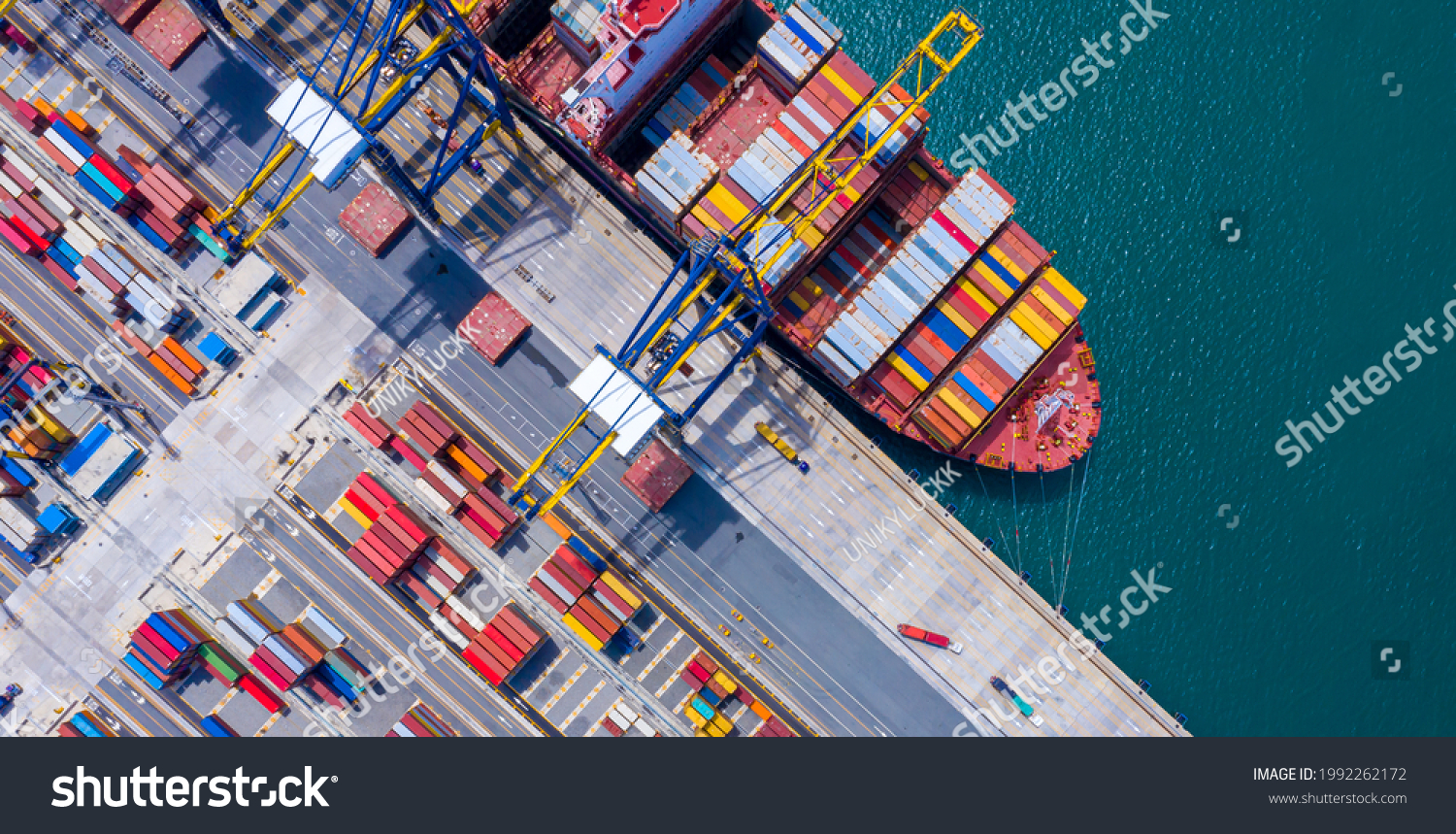 Top view of International Container  ship loading and unloading at sea port, Freight Transportation, Shipping, Nautical Vessel. Logistics, import export, oversea Transportation. #1992262172