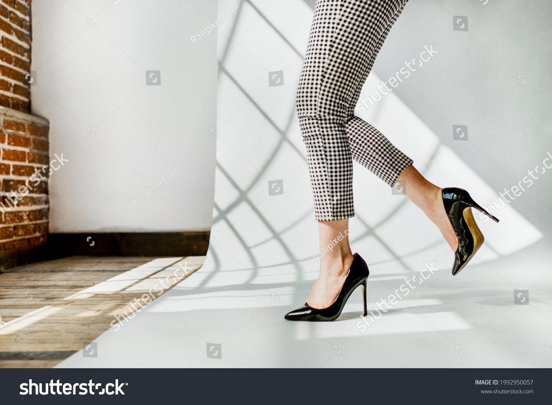 Fashionable woman in black shiny heels #1992950057