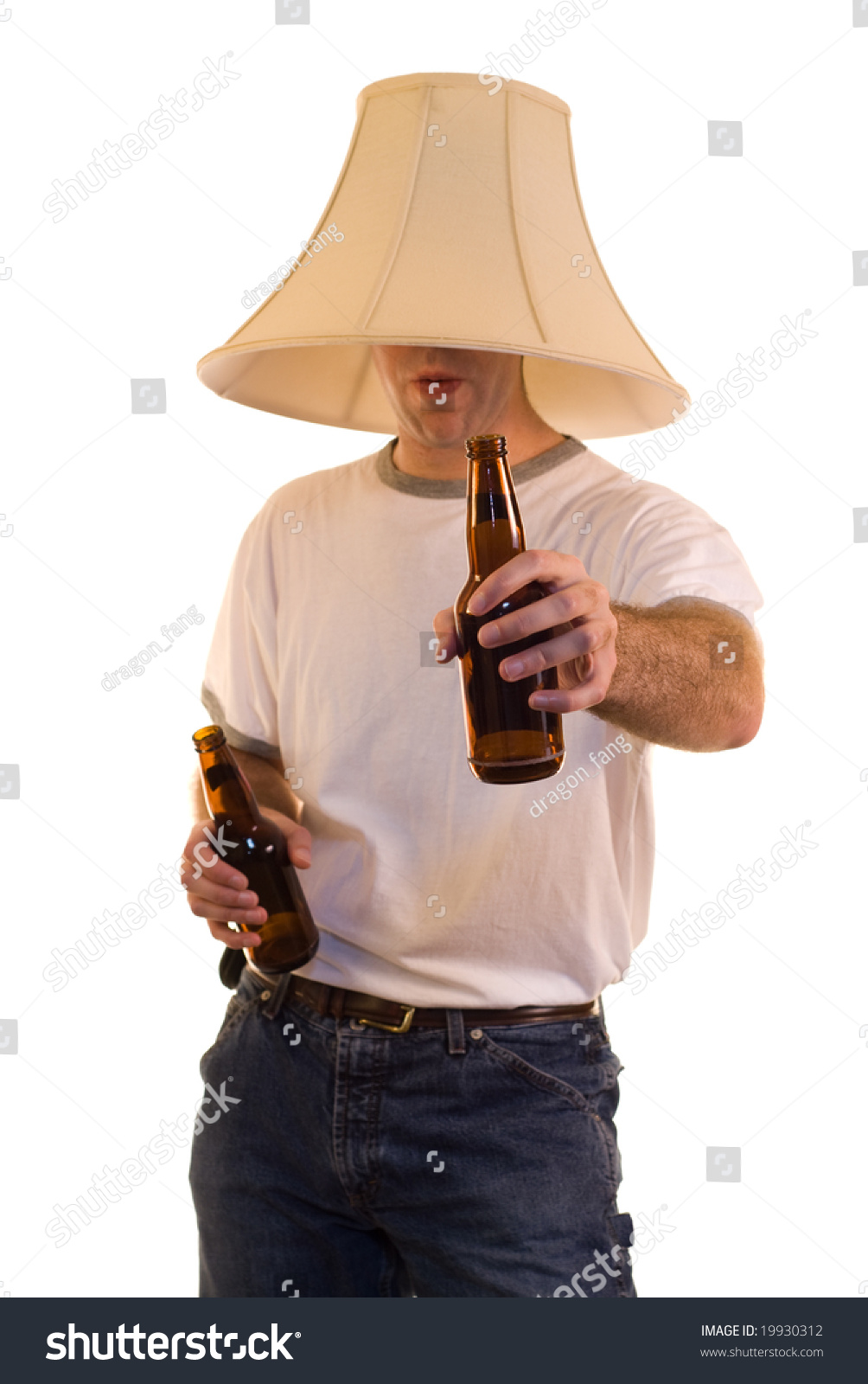 Lamp Shade On Head : Young man wearing lamp shade on stock photo