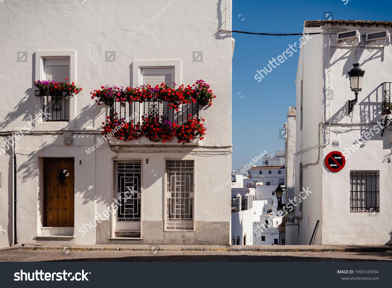 Vejer de la Frontera, Cadiz, Spain, June 11, 2021, colorful flowerpots decorate the balconies of the houses.