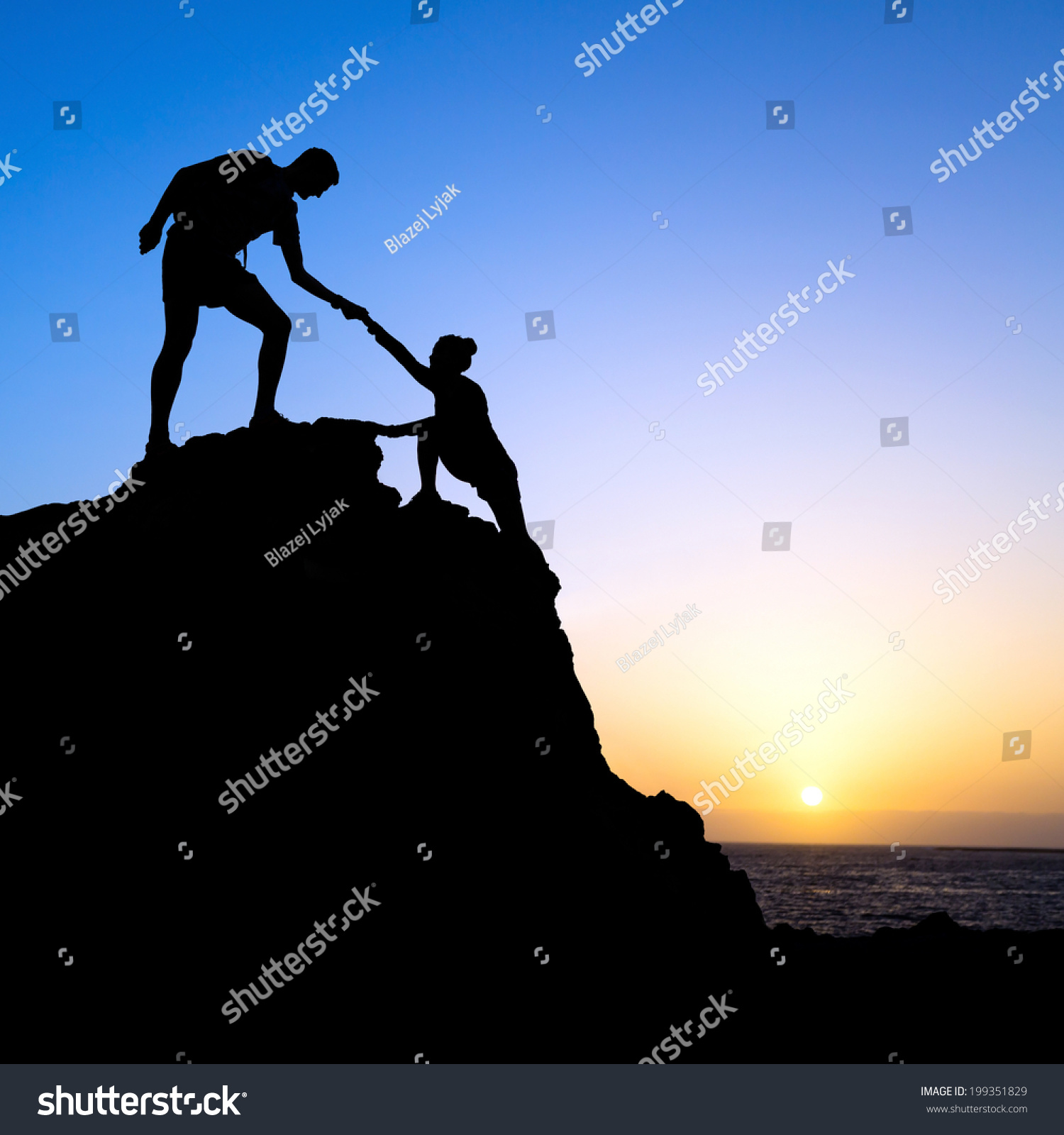 Helping Each Other: Couple Hiking Help Each Other Hand Stock Photo 199351829
