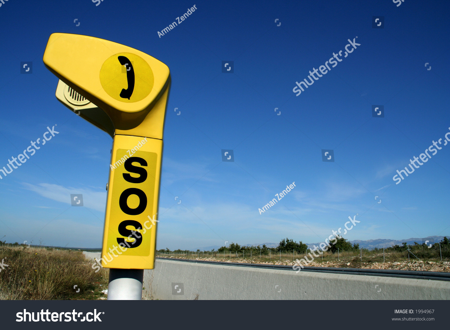 yellow sos phone box at the highway stock photo 1994967 shutterstock. Black Bedroom Furniture Sets. Home Design Ideas