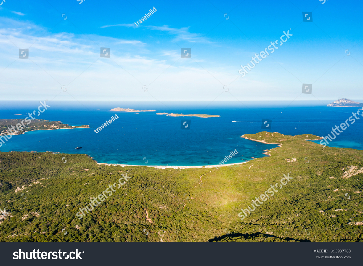 View from above, stunning aerial view of a green coastline with some beaches bathed by a turquoise sea. Liscia Ruja, Costa Smeralda, Sardinia, Italy.  #1995937760