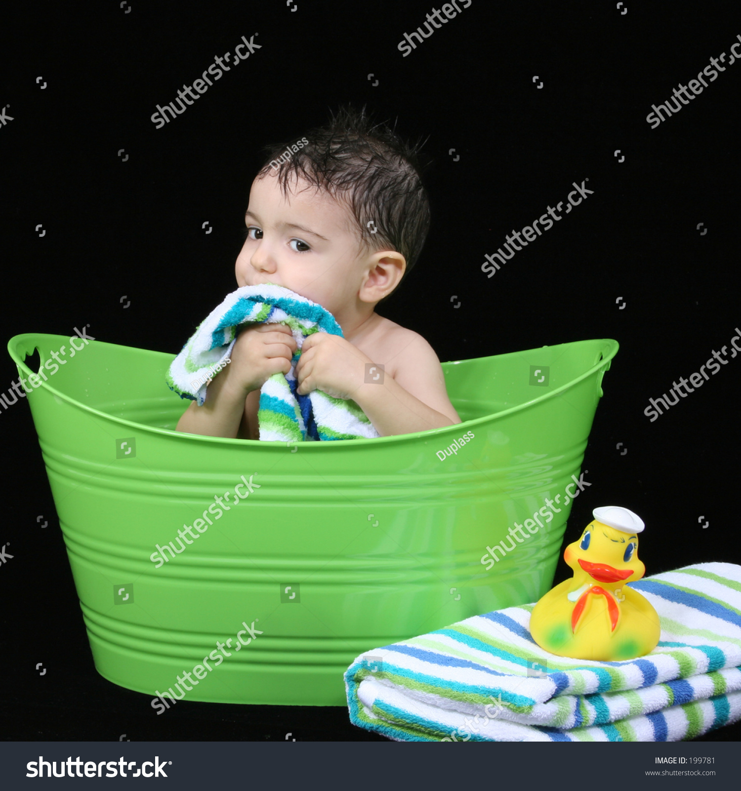 Two Year Old Boy In A Green Tub Washing His Face Stock Photo 199781 Shutte