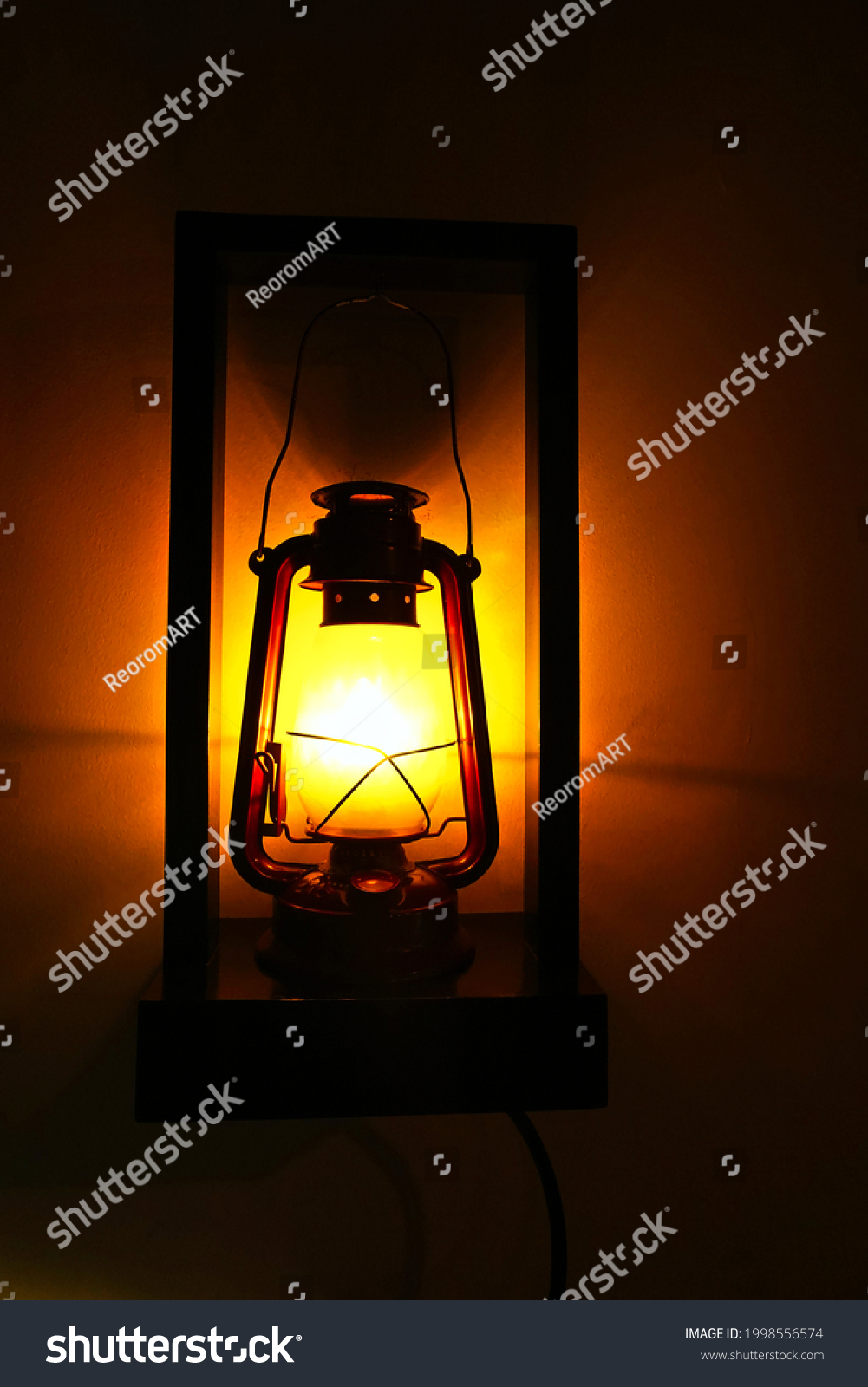 Old lantern in a room as a decoration. It is illuminated.