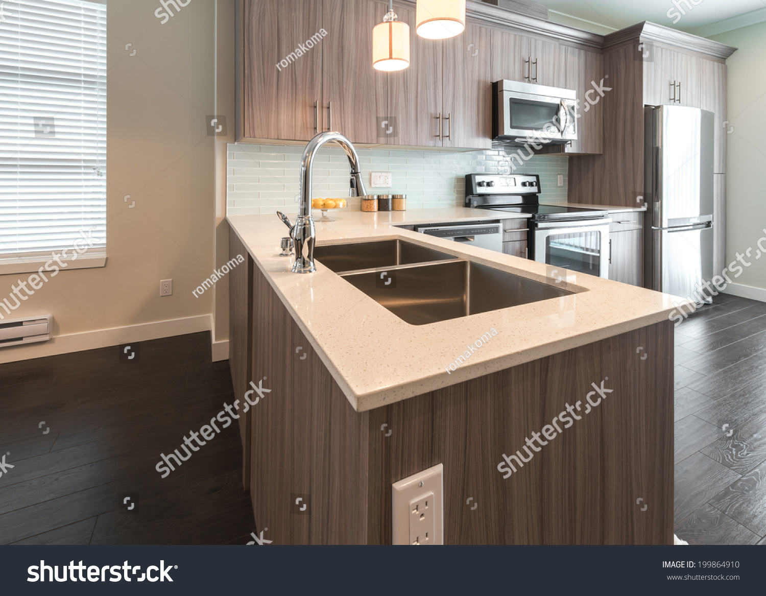 View outlook at the luxury nicely decorated modern kitchen interior design of a brand