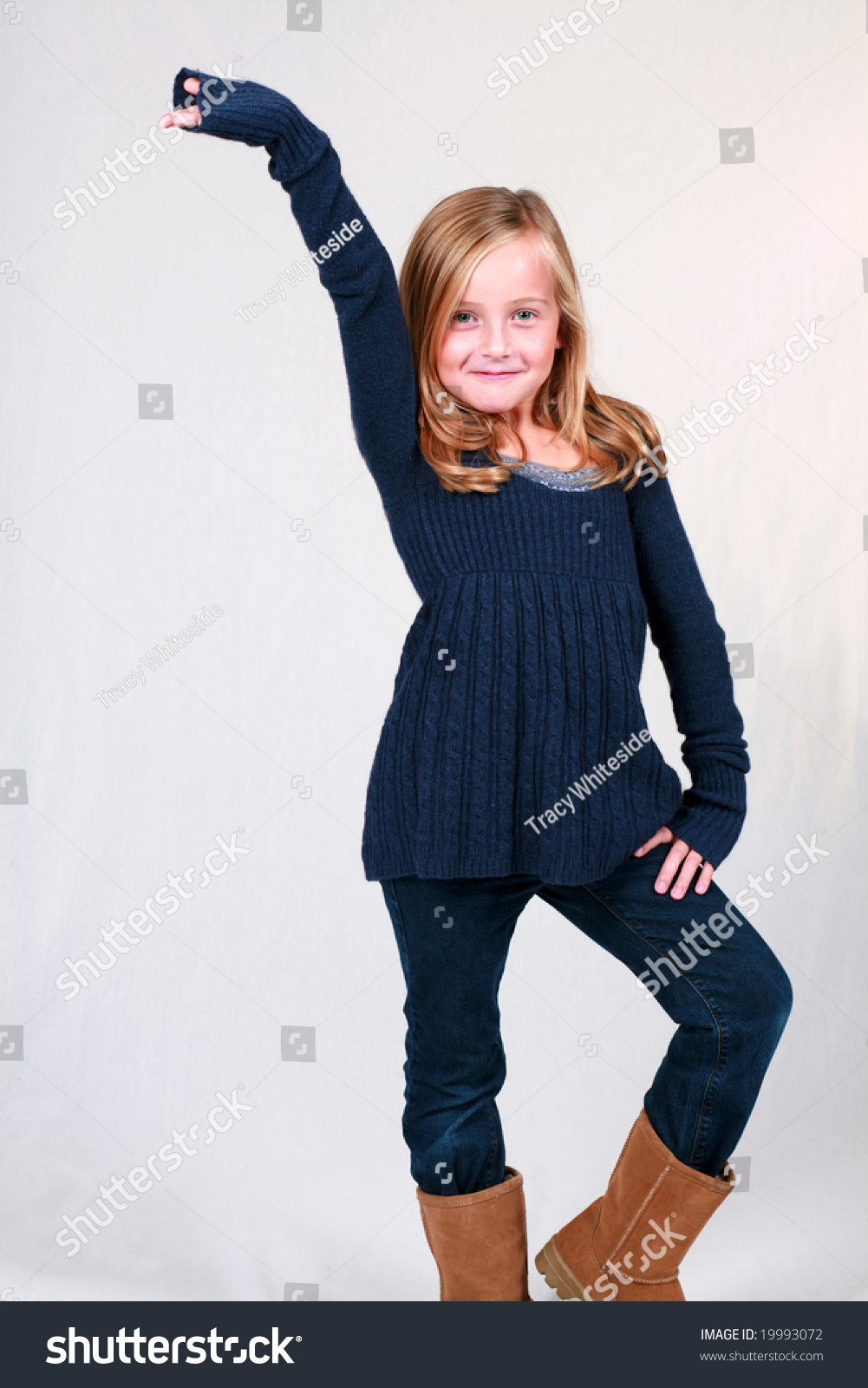 Cute Stock Photography: Cute Little Blond Girl Posing Like Stock Photo 19993072