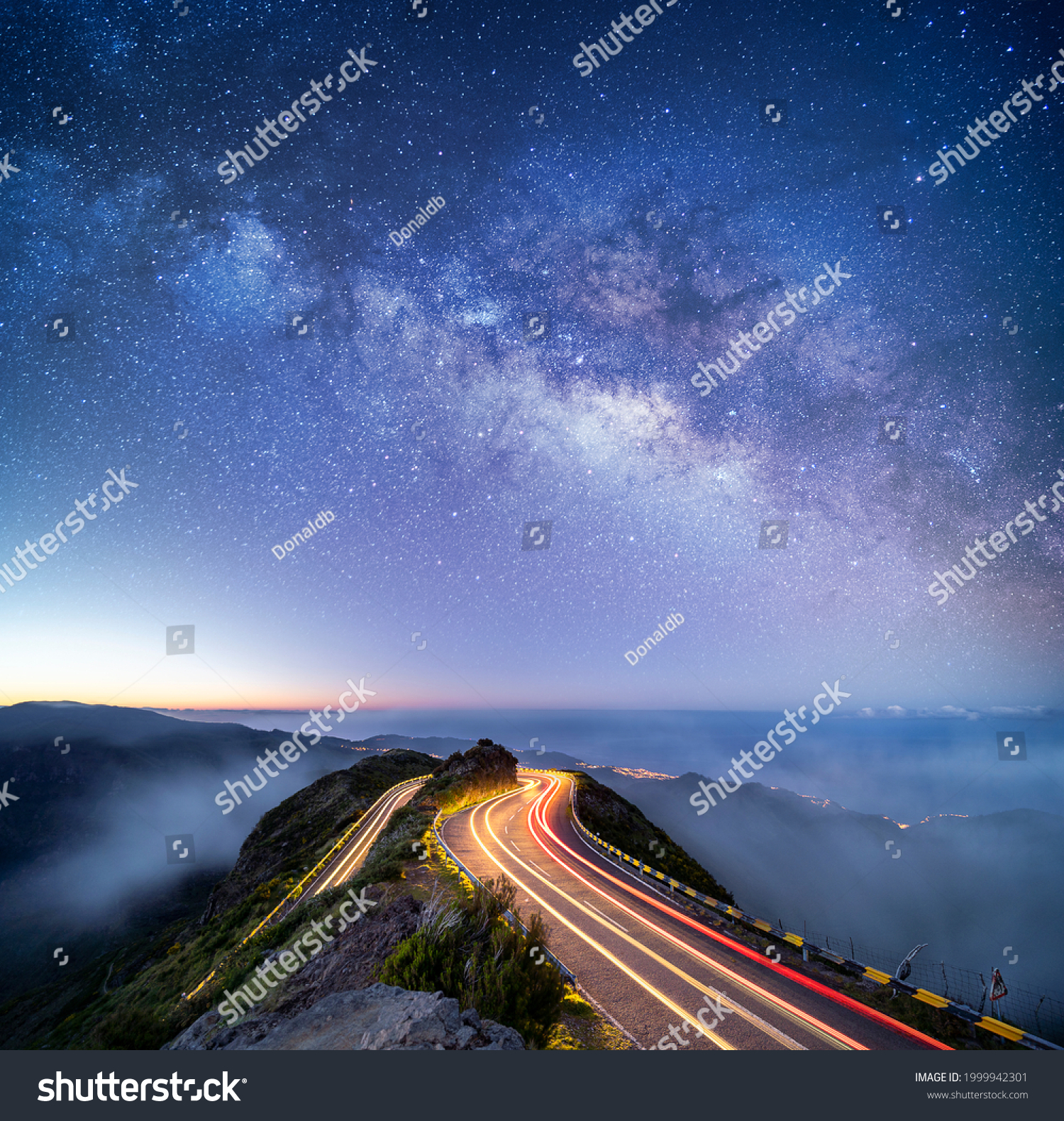 Astrophotography shot of hairpin turn with galactic core milky way rising on Madeira Island, Portugal #1999942301