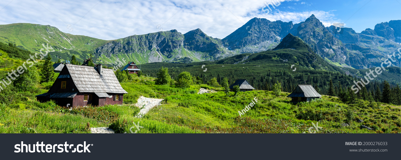 Panorama of a mountain village. Village in mountains. Village in mountain valley. Mountain village panorama #2000276033