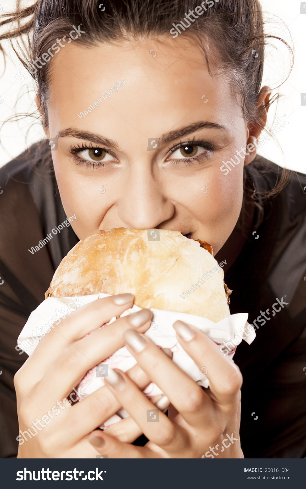 Beautiful Eat In Kitchens: Beautiful Girl Voraciously Eating Her Sandwich Stock Photo