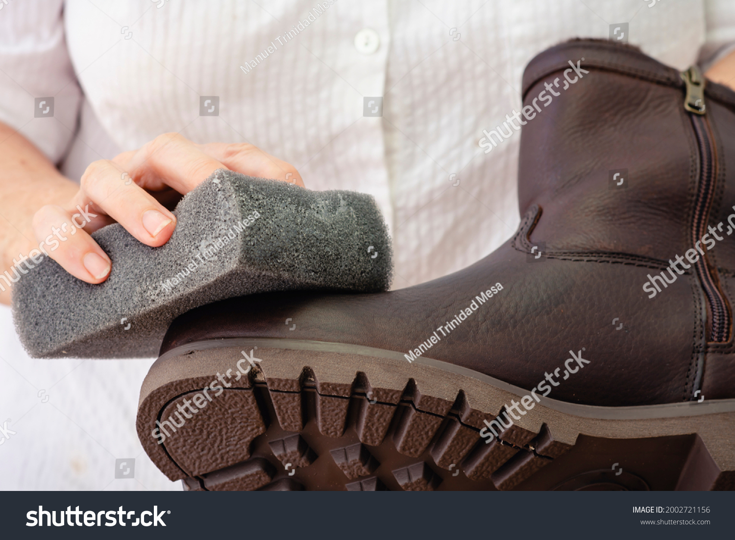stock-photo-hands-cleaning-and-oiling-a-
