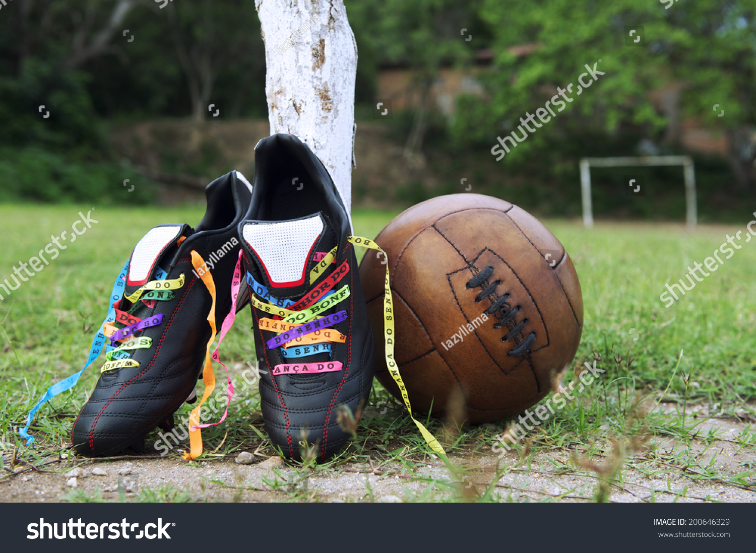 low priced 3bbca 14f6d Good luck soccer football boots soccer cleats laced with Brazilian wish  ribbons on rustic dirt grass