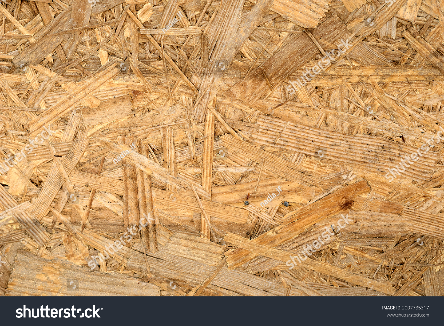 OSB board texture. Brown wooden background. Simple pressed chipboard pattern. Chip board background. Brown wood texture. High quality photo #2007735317
