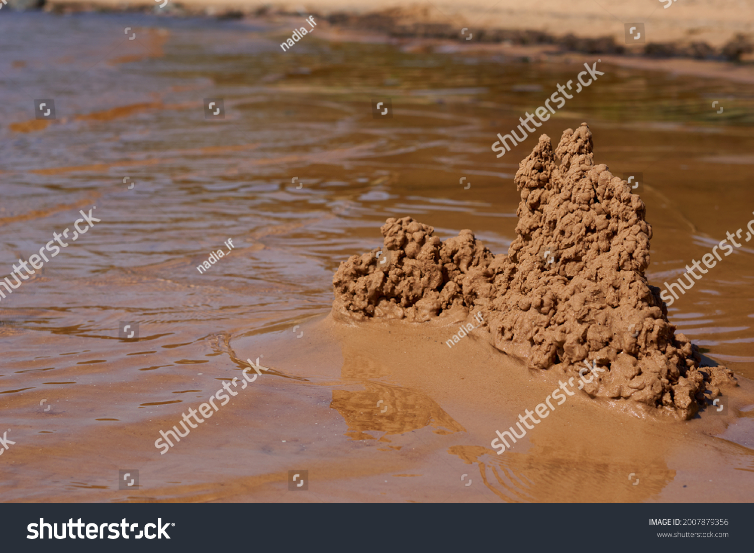 sand castle on the beach near the water. High quality photo #2007879356