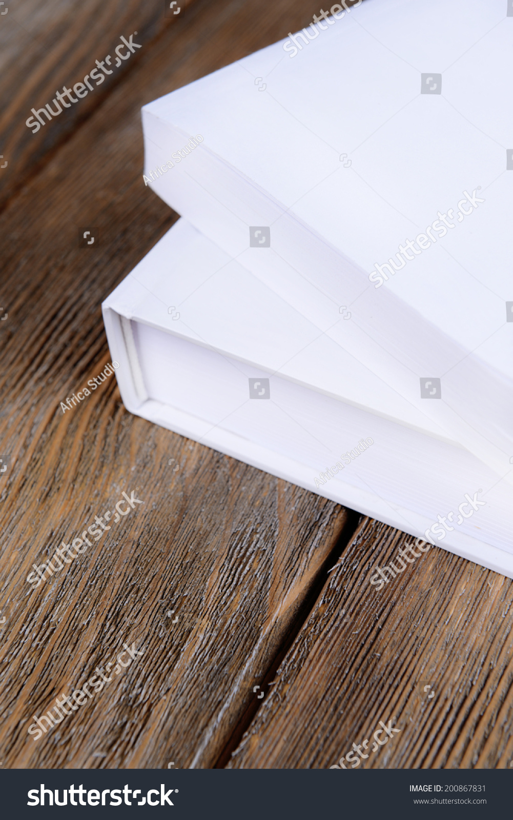 White book on wooden table closeup stock photo