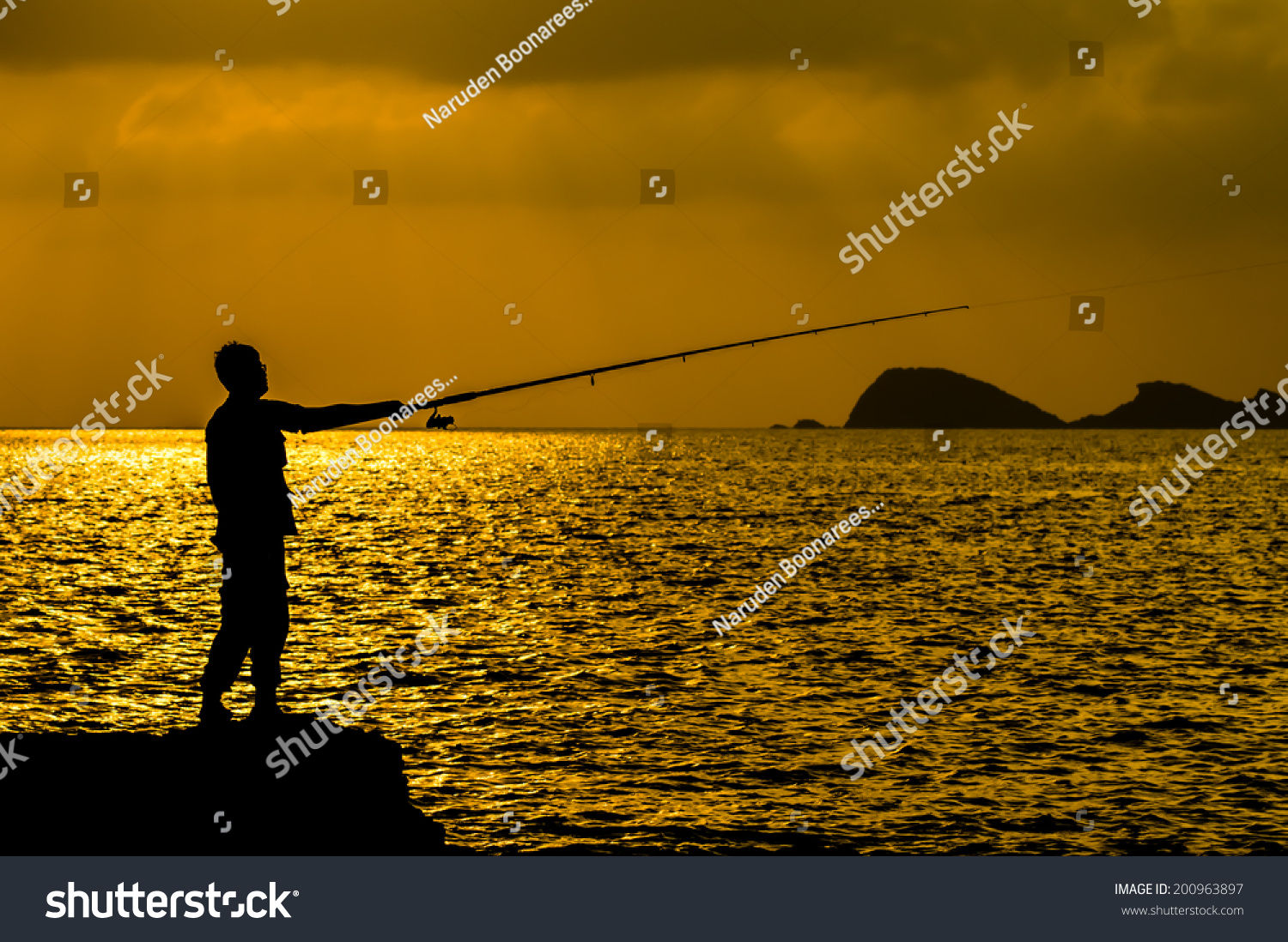 Silhouette man fishing near sea stock photo 200963897 for Where to get a fishing license near me