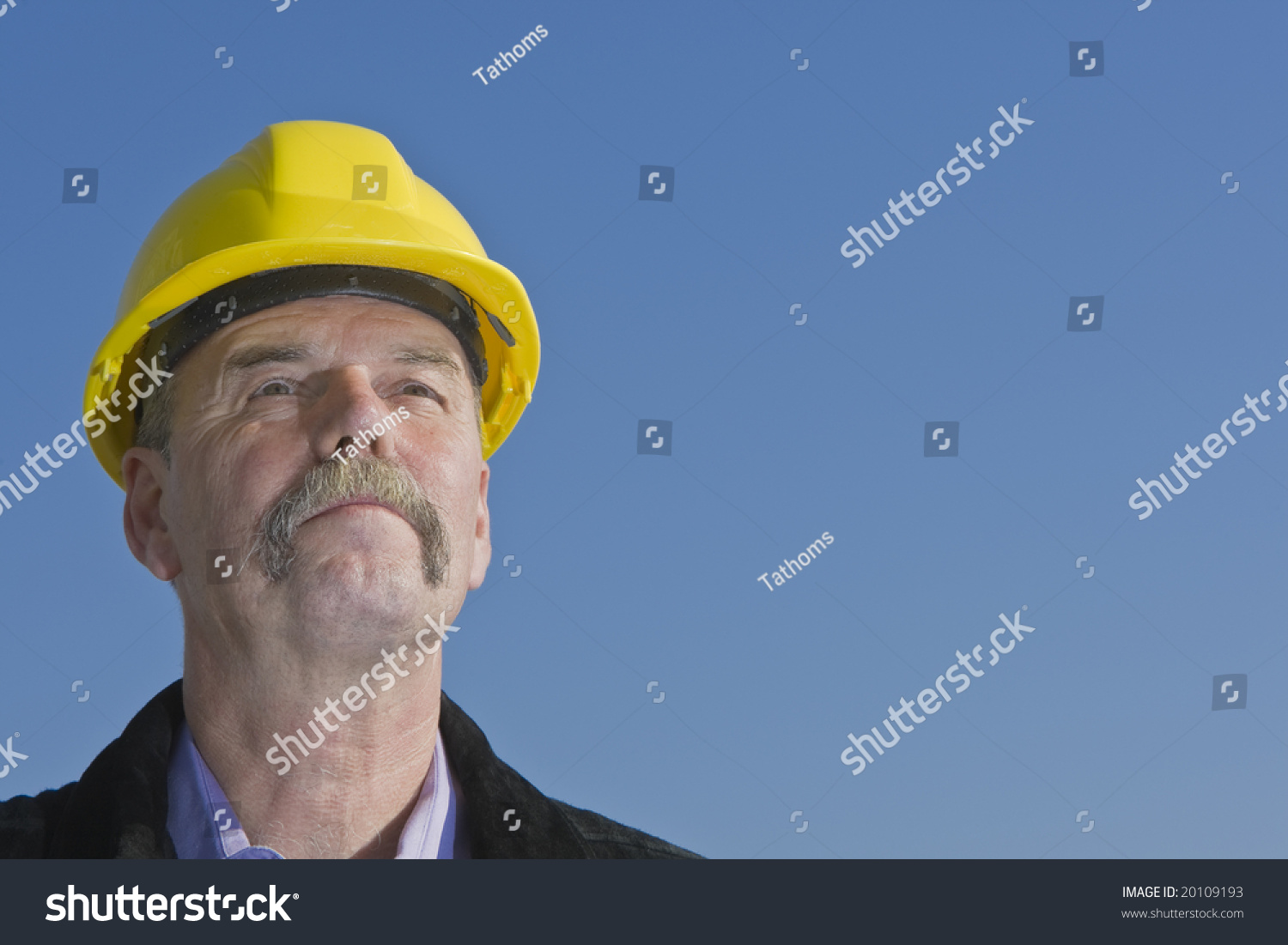 stock-photo-architect-checking-out-his-b